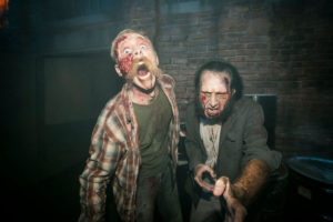 Two guys yelling at the camera, both with cuts and blood on their face.